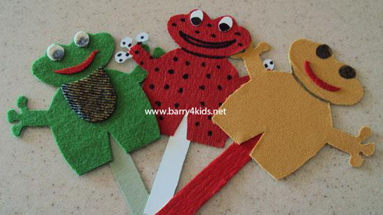 stick puppets, green, red and yellow frogs